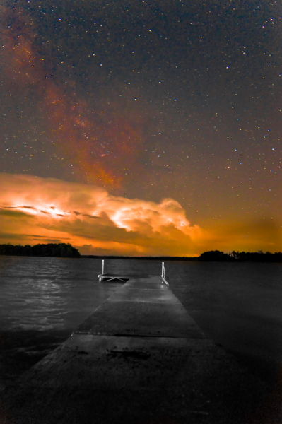 milky way above a thunder storm could over water