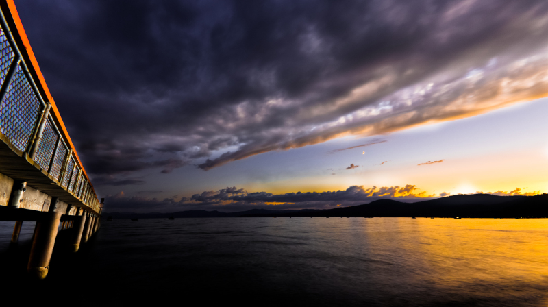 sunset picture of lake tahoe with storm coming