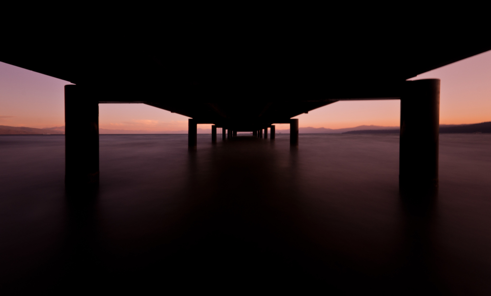 long exposure shot of a dock at lake tahoe sunset