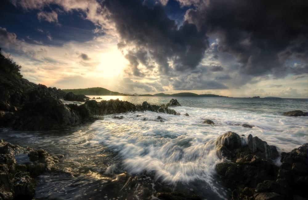 waves crashing over rocks at sunset on St. John