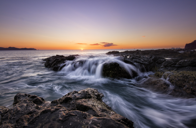 long exposure ocean tide at sunset in costa rica