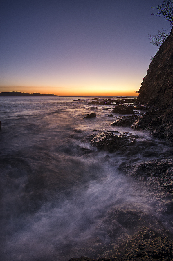 long exposure of ocean tide at sunset
