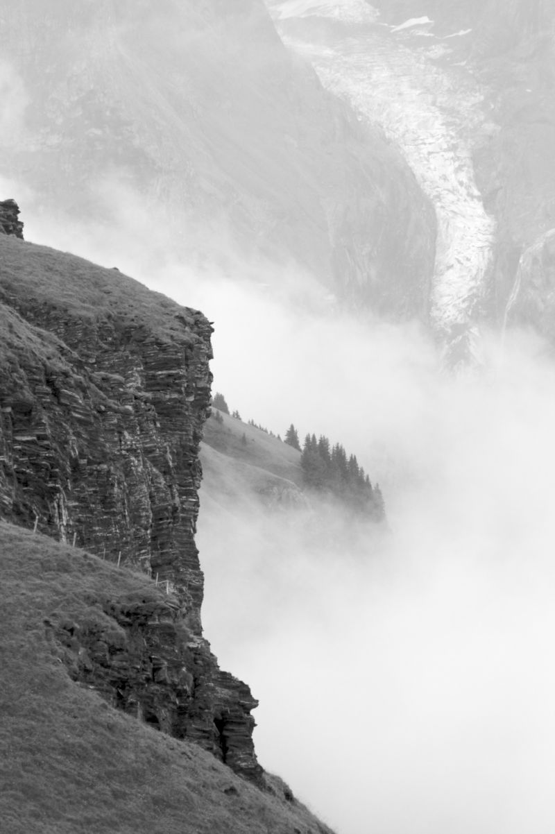 Crags and Glacier poke through the clouds