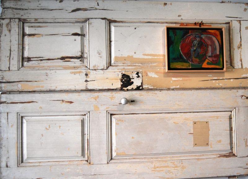 Quadro na velha porta deitada