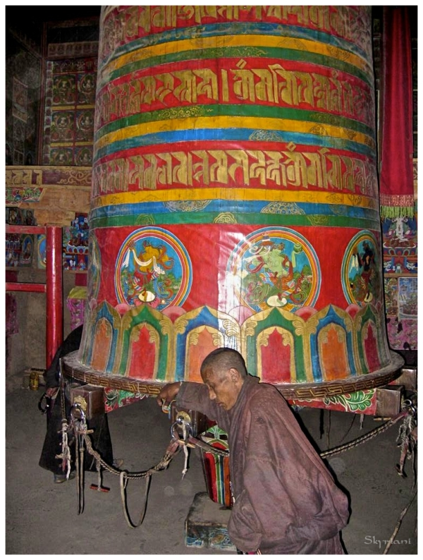 Monk spinning giant prayerwheel