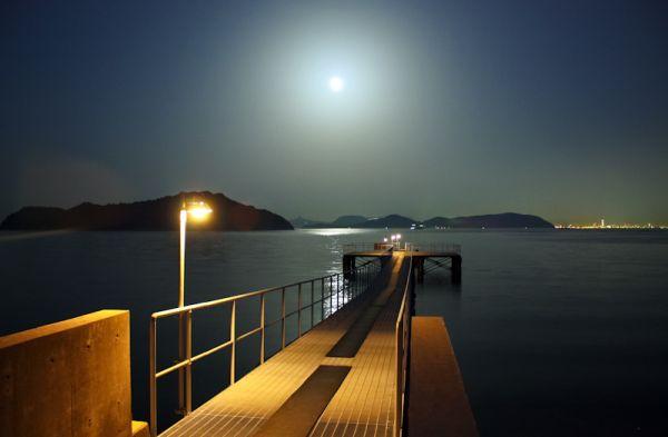 A moon-lit pier on the island of Naoshima.