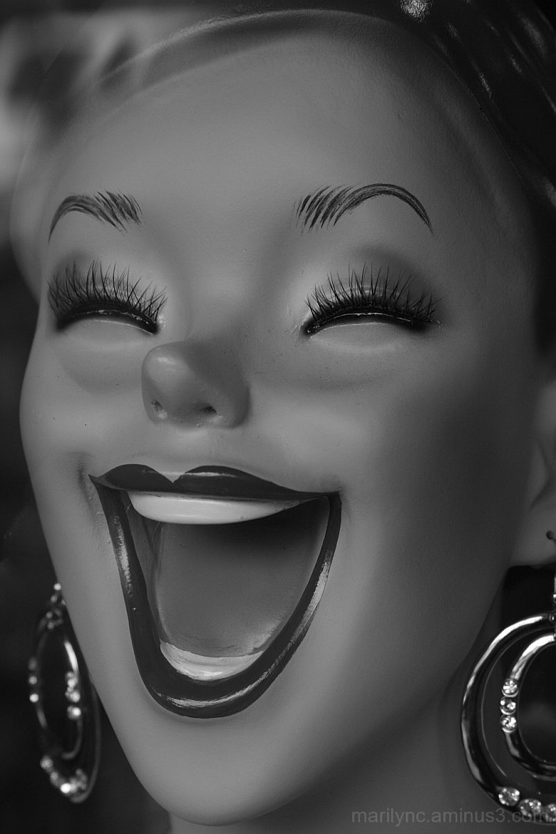 Black and white of a laughing manequin face