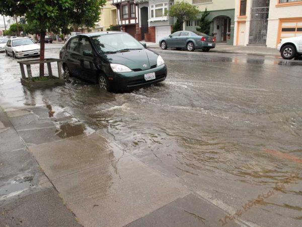 Avenue flooded by water main break.