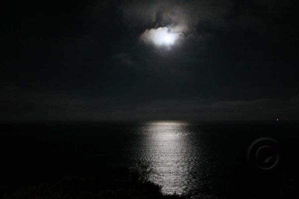 Moon Peeking Through Clouds