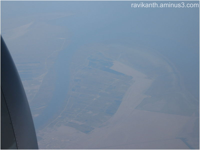 A city on sea shore, looks beautiful from 30000 ft