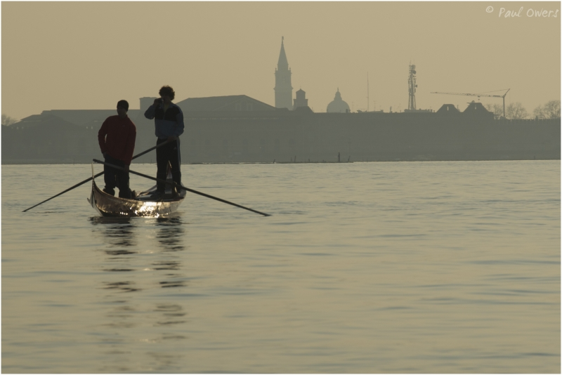 Gondoliers on Venice lagoon