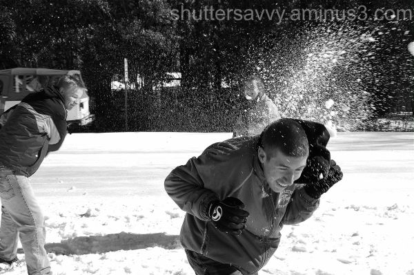 boys throwing snowballs