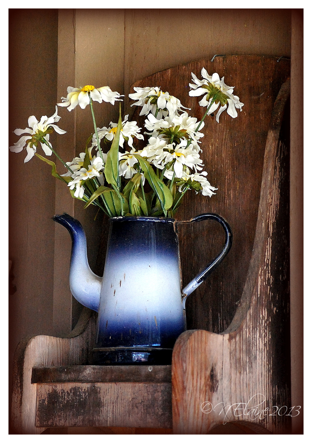 flowers in a pot on a shelf