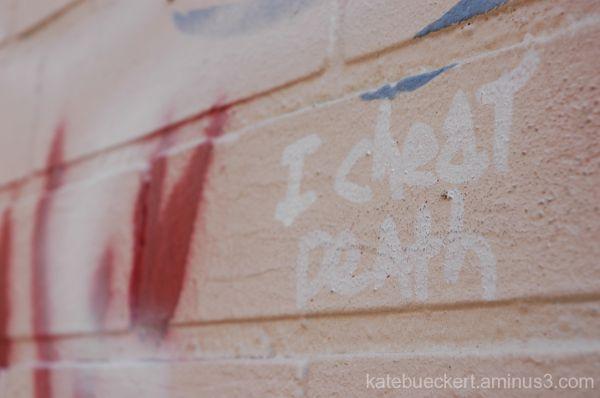 Downtown graffiti - I cheat death