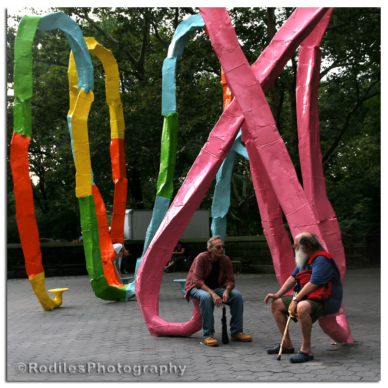 Let's sit on the sculptures