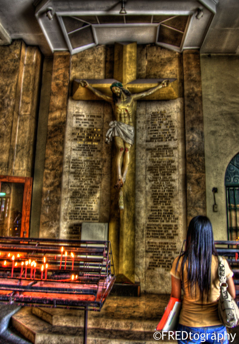 A woman looking up to the crucifix.