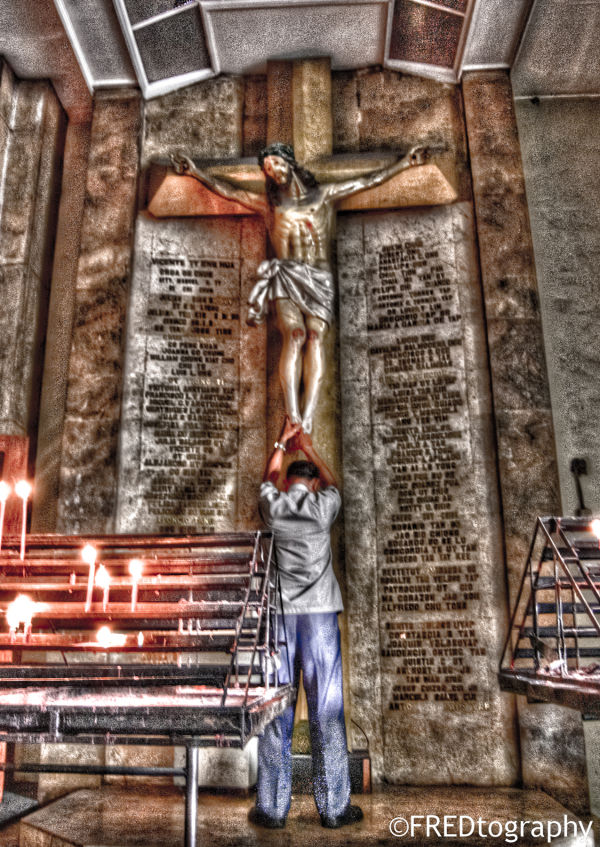 A man asking for something on the Crucifix.