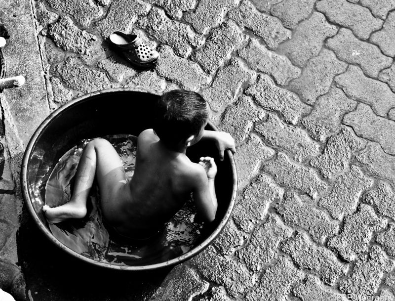 A child playing in the tub.