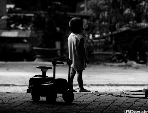 A child leaving his toy.