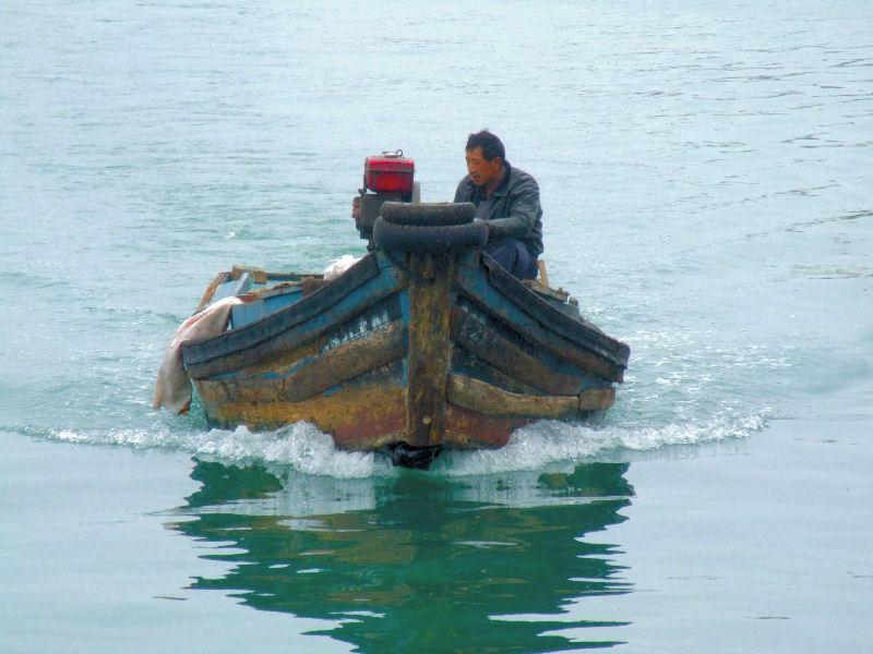 A Fishing boat heads toward port.