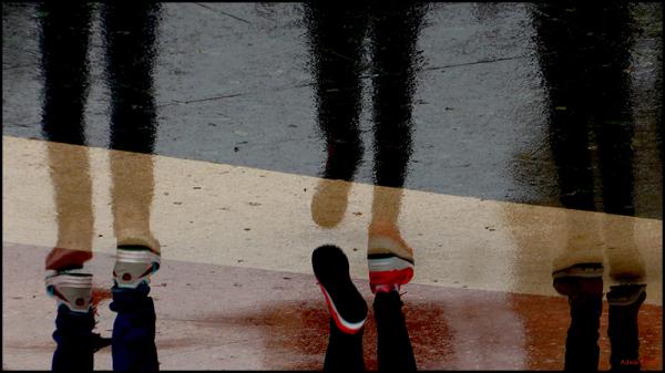 * Caminar sota la pluja