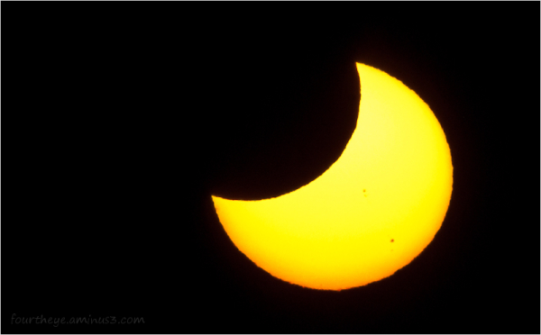 partial solar eclipse at sunset