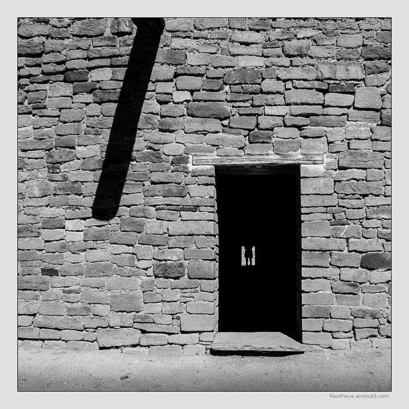 woman through kiva door