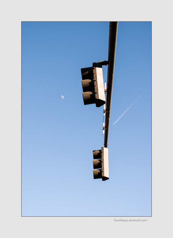 stoplight with moon and jet