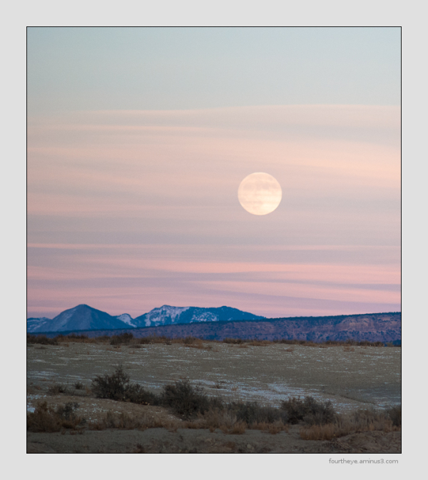 full moon rising at sunset