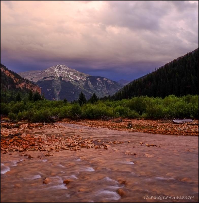 Summer mountain storm at sunset