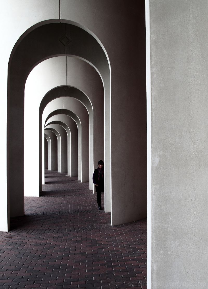 woman in hall of arches