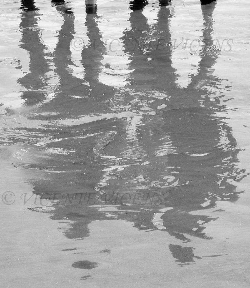 SHADOWS IN THE BEACH.