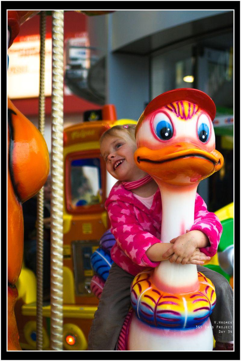 girl on a merry-go-round