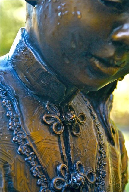 Close up photo of bronze girl statue