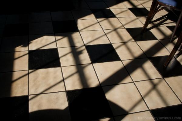 strong sunlight on black and white tile restaurant
