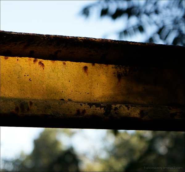 abstract photo of yellow and rusted metal