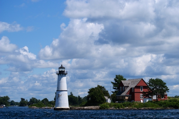 river lighthouse on a sunny day with clouds