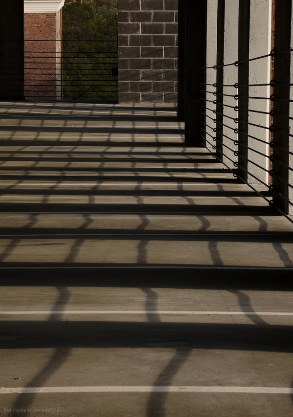 repetition of rail in sunlight and shadow