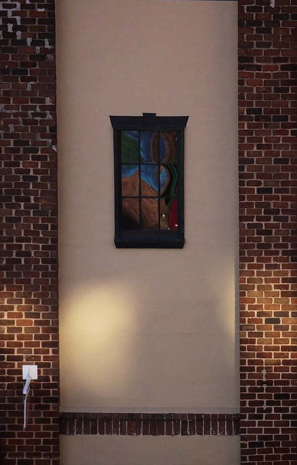 red brick building with reflection in the window