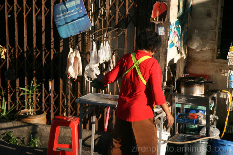 A man in Phuket, Thailand doing some housework.