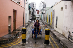 Riding down the alleyways of Little India.