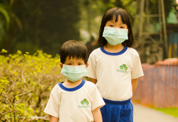 Children in Singapore bracing the haze.