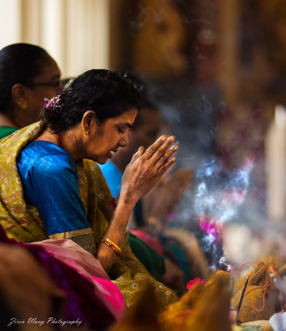 A Hindu lady praying at a temple in Singapore.