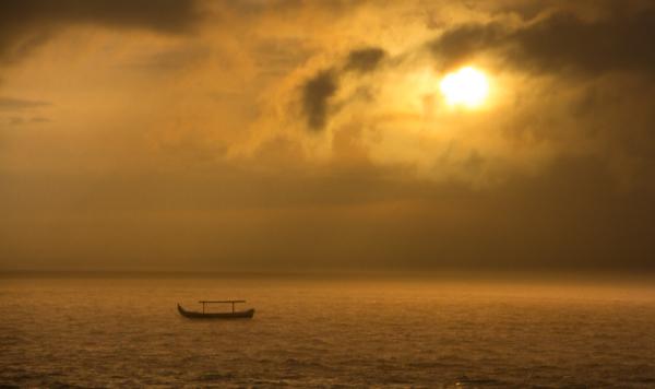 Sunset along Legian Beach in Kuta. Bali, Indonesia