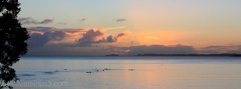 Canoeists at sunrise