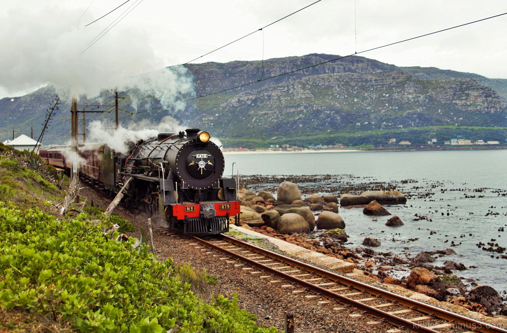 Steam train by the sea