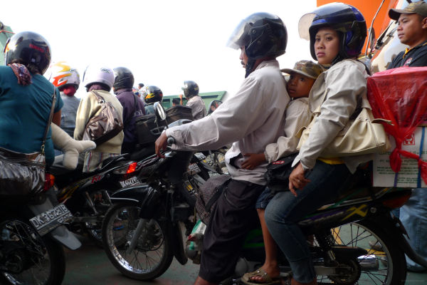 A family on the motorbike waiting to arrive