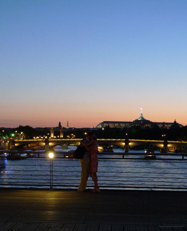 Couples near on a bridge near les tuileries