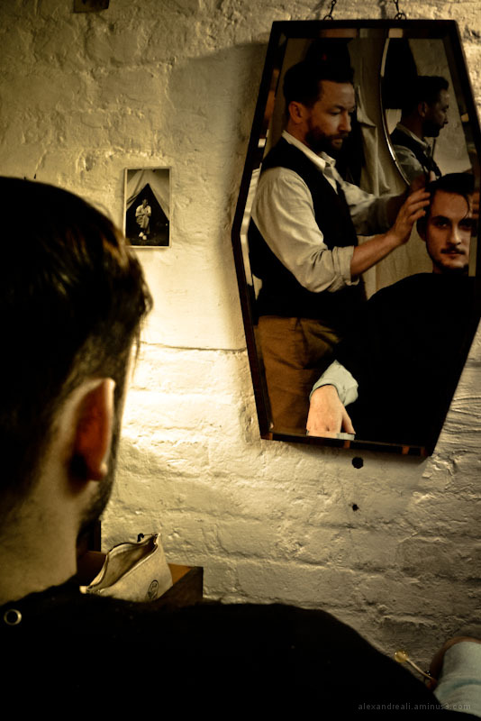 Friend doing a haircut in a fashion men barber