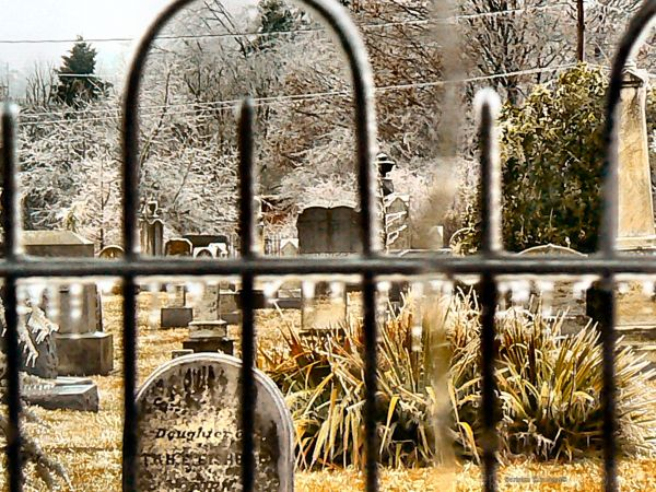 small rural cemetery after an ice storm.